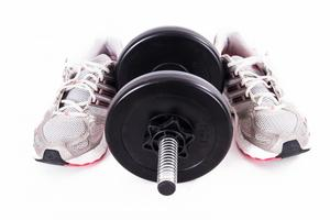 weight lifting shoes and dumbbell